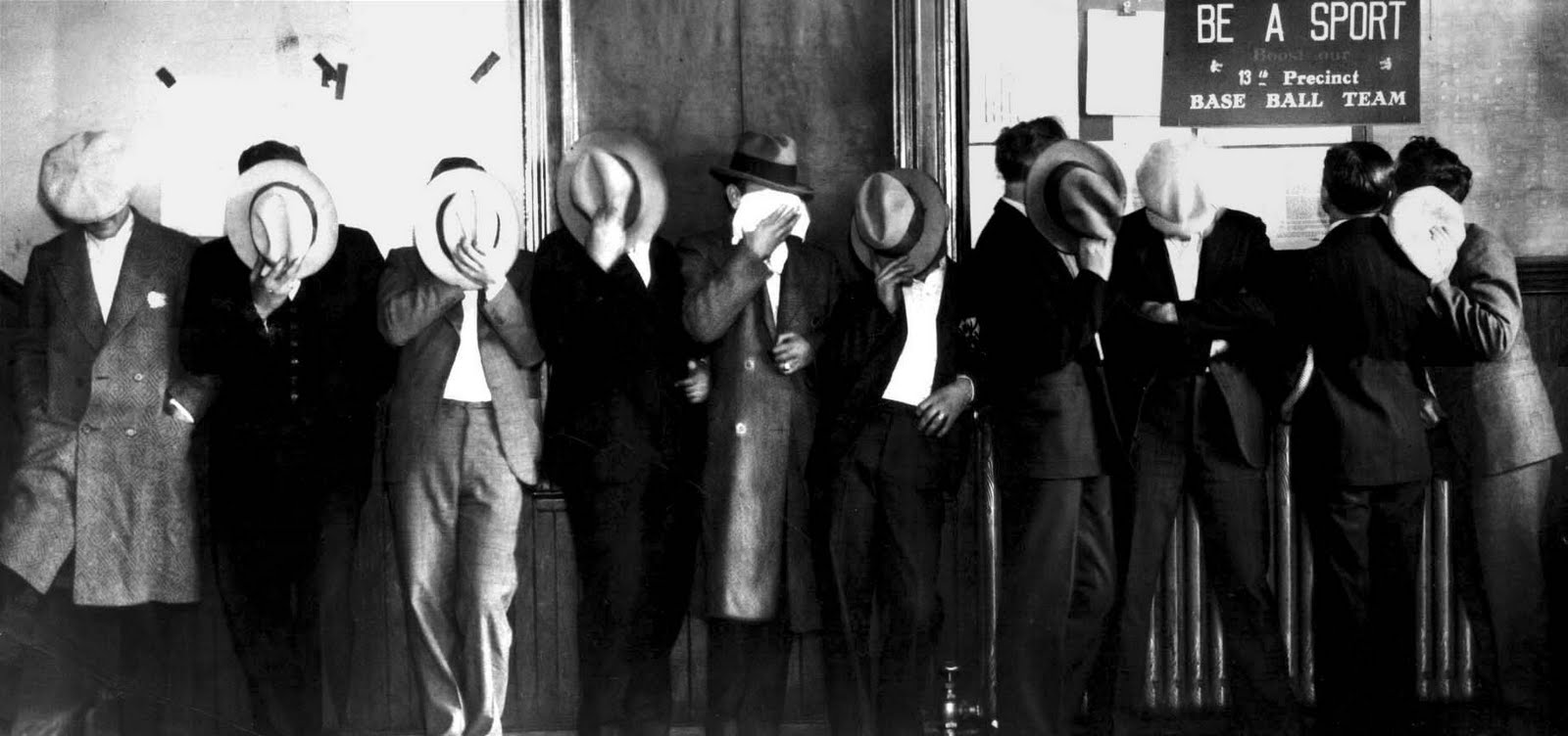 Members of Detroit's Purple Gang Hide Their Faces After Arrest