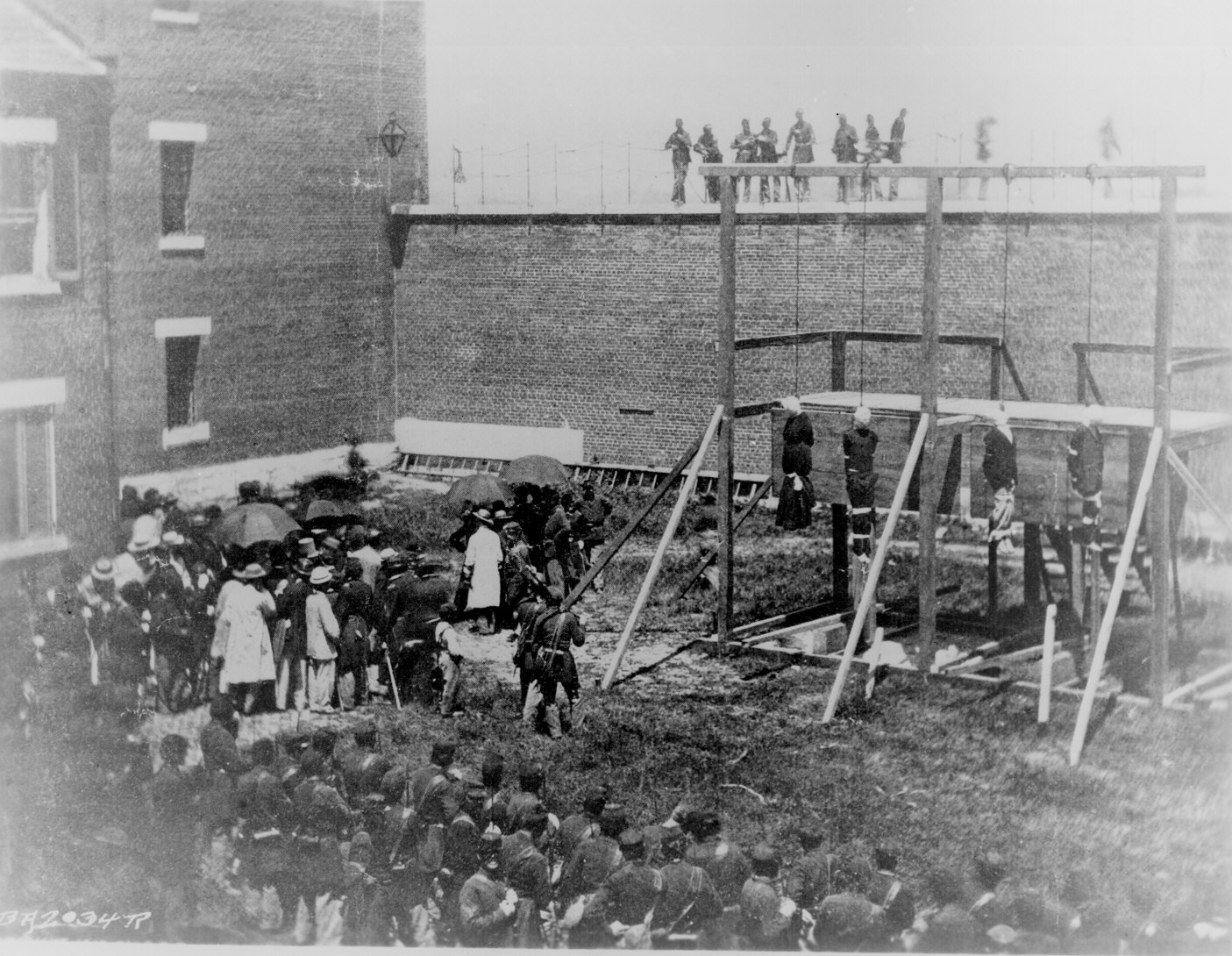 Execution of Mary E. Surratt, Lewis T. Powell, David E. Herold, and George A. Atzerodt as as conspirators in the Lincoln Assassination, July 7,1865. Photographed by Alexander Gardner. 111-BA-2034