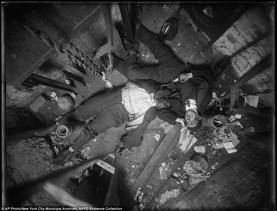 Elevator operator Robert Green, left, and Jacob Jagendorf, a building engineer, right, found lying at the bottom of an elevator shaft November 24, 1915