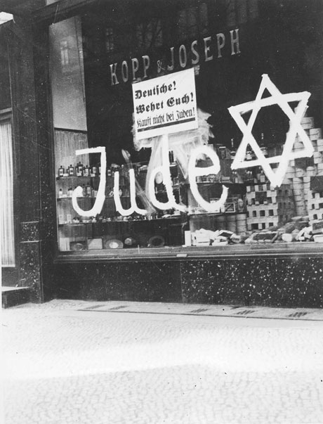 "A sign on a store owned by German Jews: ""Protect Yourselves, Don't Buy from Jews!"""