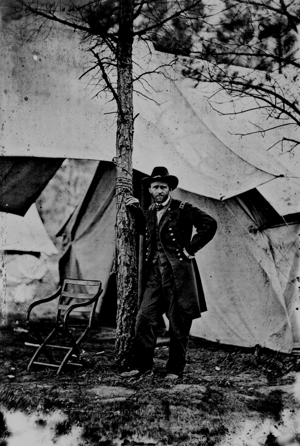 Lt. Gen. Ulysses S. Grant standing by a tree in front of a tent, Cold Harbor Virgina June 1864. 111-B-36.