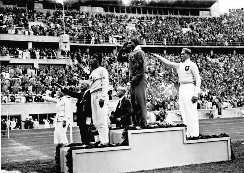 Jesse Owens after Winning the Long Jump at the 1936 Olympics