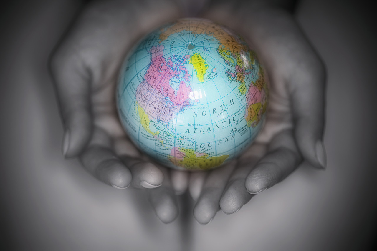world in cupped hands