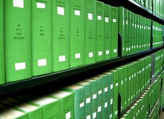 Image of a green shelf of print indexes.