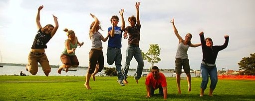 Image shows 8 people jumping in the air.