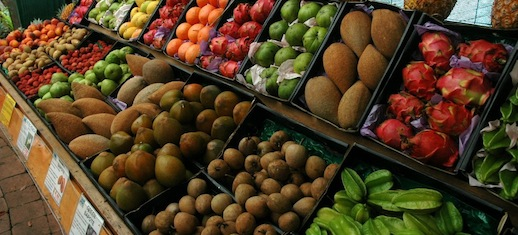 Image of a variety of tropical fruits in a fruit stand.