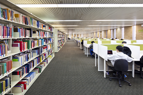Students in the Melbourne campus library