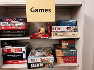 Shelf of games in microforms room