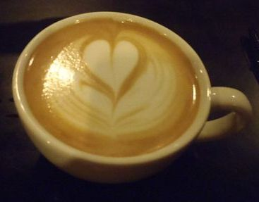 photograph of latte with a heart design in the foam