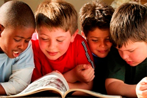 boys reading a book