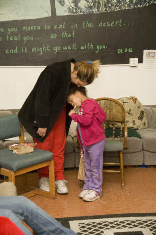 Volunteer and child at homeless shelter