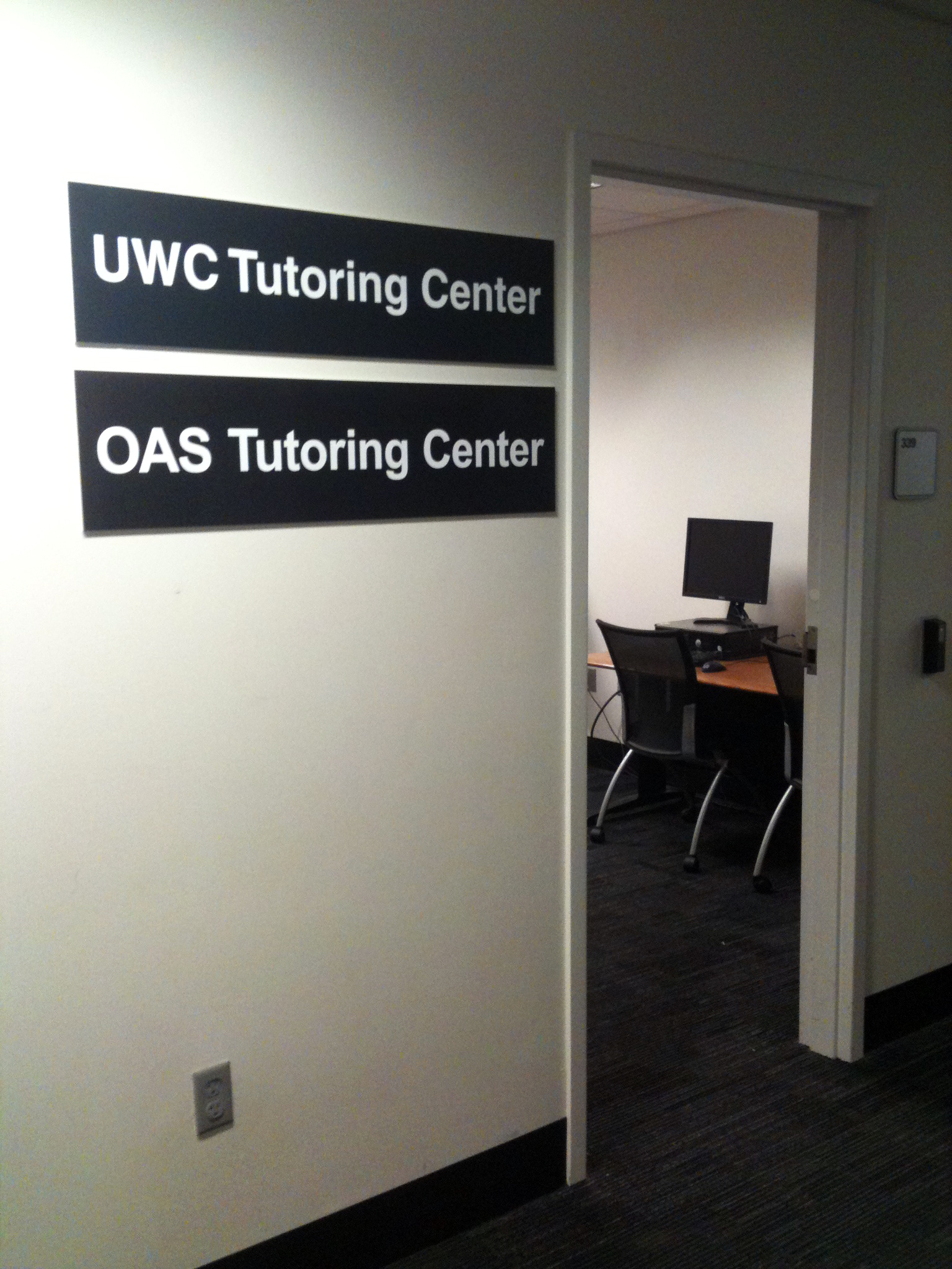 FREE TUTORING IN LIBRARY WEST. Picture of entrance of Library West Tutoring Center, Room 339