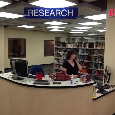 Necia at Research Desk; photo by A. Festa