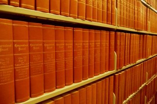 government publication in print on shelf, multiple volumes (decorative)