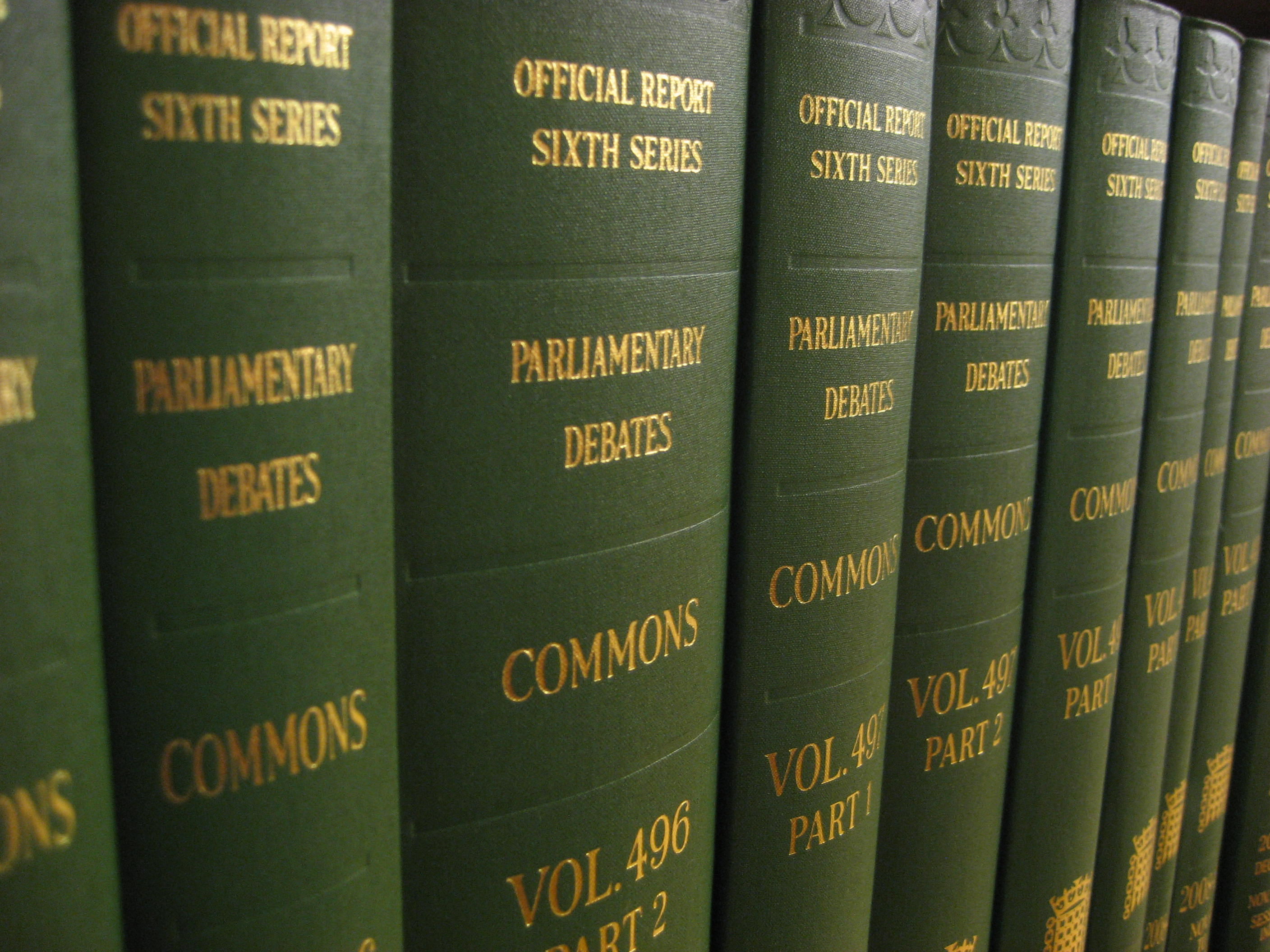 Image shows House of Commons bound volumes on a book shelf