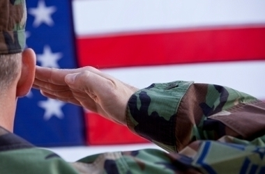 Soldier saluting the U.S. flag