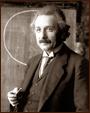 Photo of physicist Albert Einstein in front of a blackboard