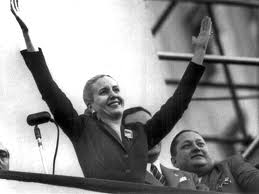 Eva Peron with hands in the air