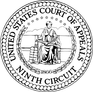 A black and white medalion with a seated woman in ancient greek dress. She holds an hopen book and two stone tablets lean against the her seat. The text reads United States Court of Appeals / Ninth Circuit.
