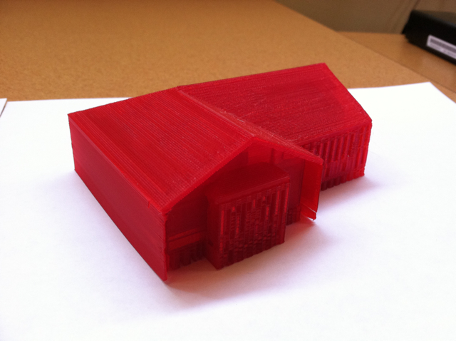 Scale building model with pitched roof in red