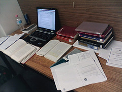 Working in a library writing an essay