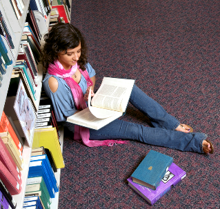 Student browsing book in library