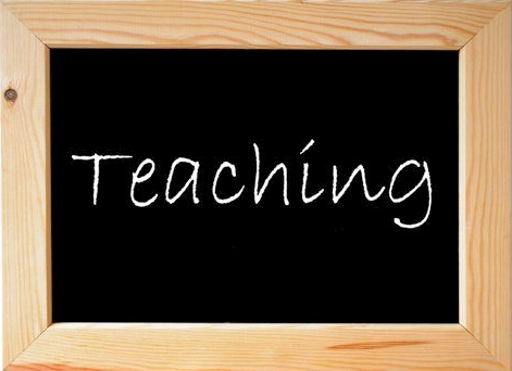 Image:  Black board with the word Teaching written on it
