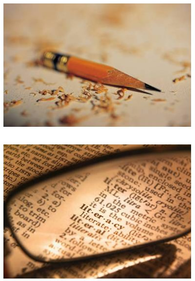 """A sharpened, worn-down pencil and the word """"literacy"""" on a dictionary page"""