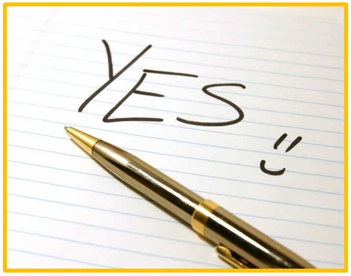 "The word ""Yes"" and a smiley face, next to a ballpoint pen"