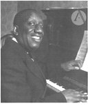 photo of James P. Johnson playing the piano