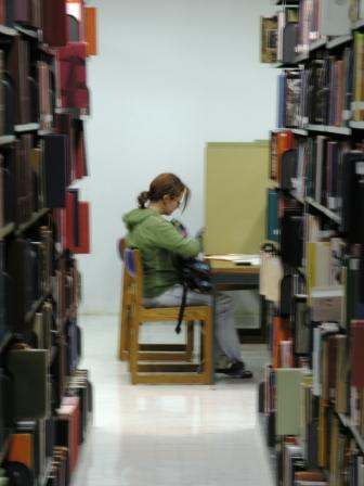 photo of student reading in the library