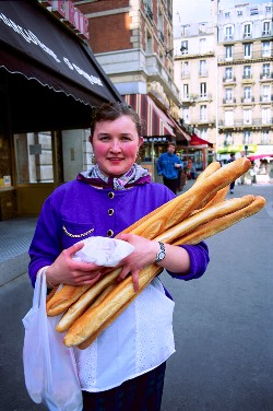 Woman holding French bread