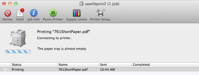 Screenshot of Macbook printer error box with a swirling connection line on it