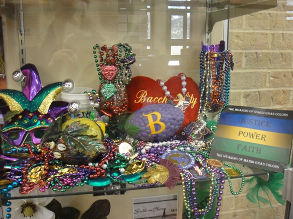photo of library exhibit displaying Mardi Gras related items