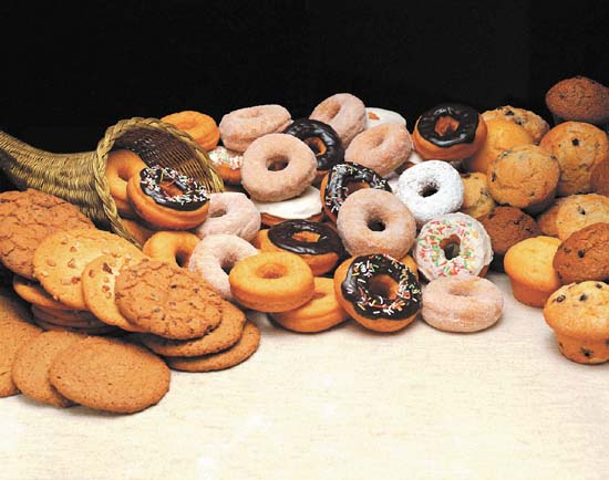 a cornucopia of cookies, donuts, and muffins