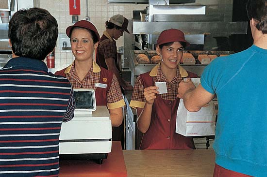 teenagers work at fast food counter