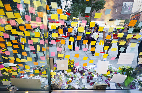 window covered with post-it notes and a table with flowers and apples