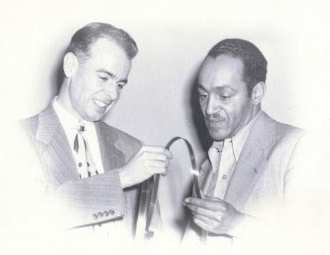 Willard Motley (right) examines film from Knock On Any Door
