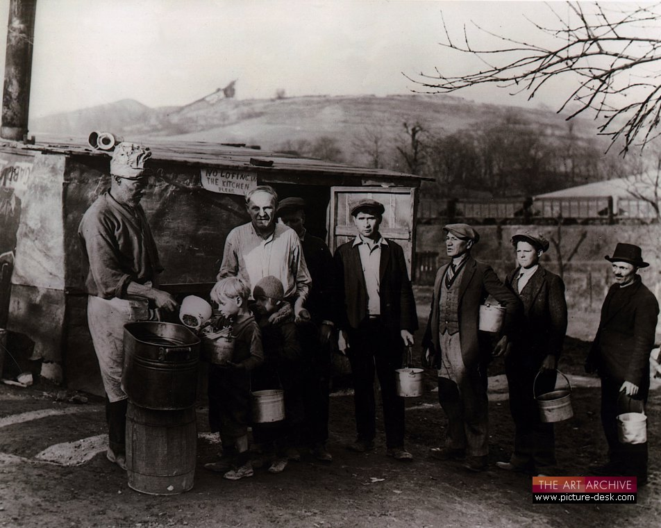 Miners and their children queueing at US Army soup kitchen