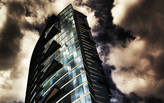 Tall building against a dramatic sky