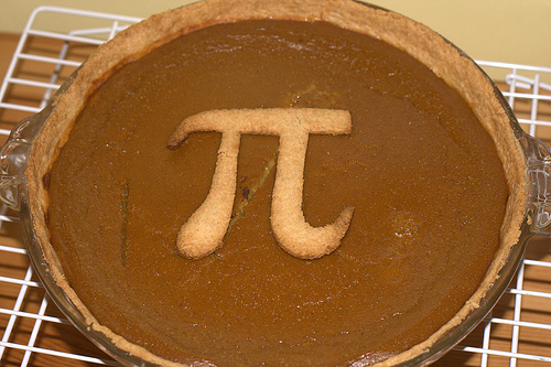 pumpkin pie with the greek symbol for pi on it