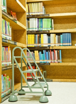 Library shelves with stair