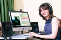 Picture of student listening to music online