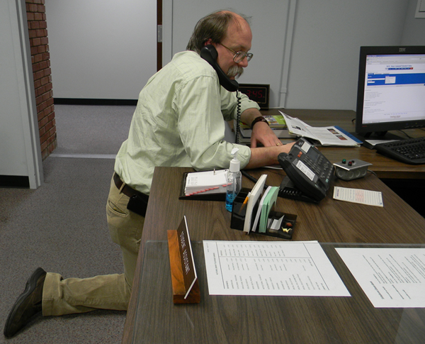 Head of Special Collections on his Knees for Patron Needs