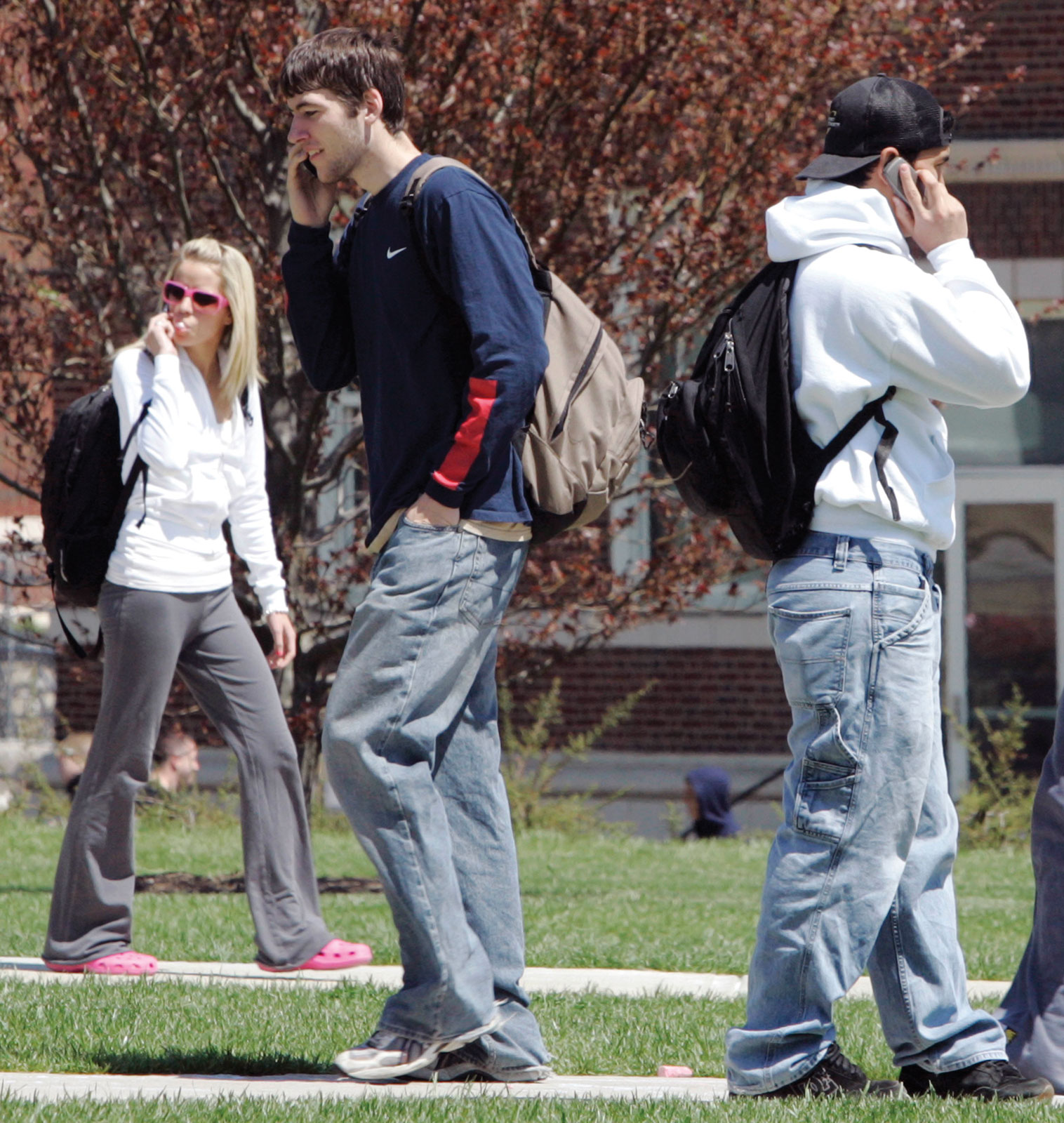 college students on cell phone