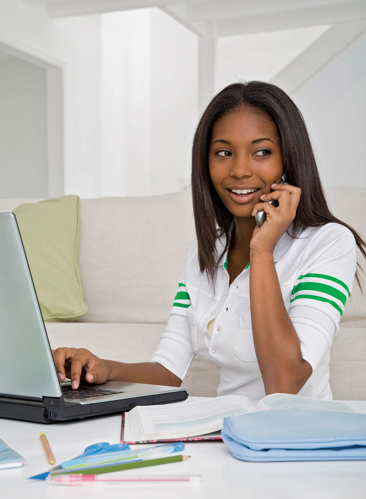 teenage girl on cell phone and laptop