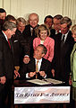 President George W. Bush signing a tax cut law (Wikimedia Commons)