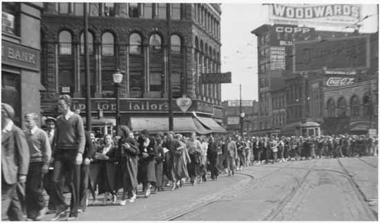 Men and women marching in May Day parade for unemployed during the Depression