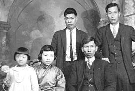 Studio family portrait of 3 men, 1 woman and child, VPL #58914, 192_, C.B Wand.