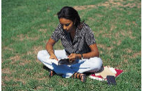 Women reading on the grass